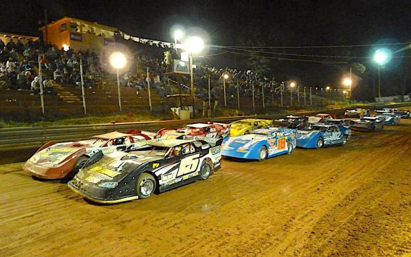 Cars running two across roar down the straightaway during a feature race at Toccoa Raceway. Photo racingin.com