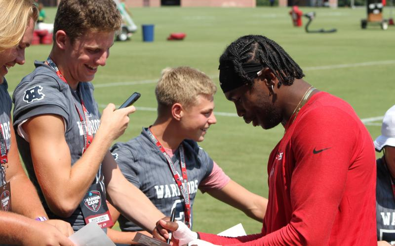 WCHS players, from left, Jacob Anderson, Jimmy King and Nix Burkett share a laugh with the Falcons' All-Pro receiver Julio Jones.