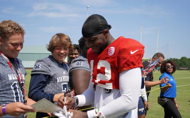 Atlanta Falcons' receiver Mohamed Sanu, right, signs an autograph for Caden VerSluis and Alex Thornton after practice.