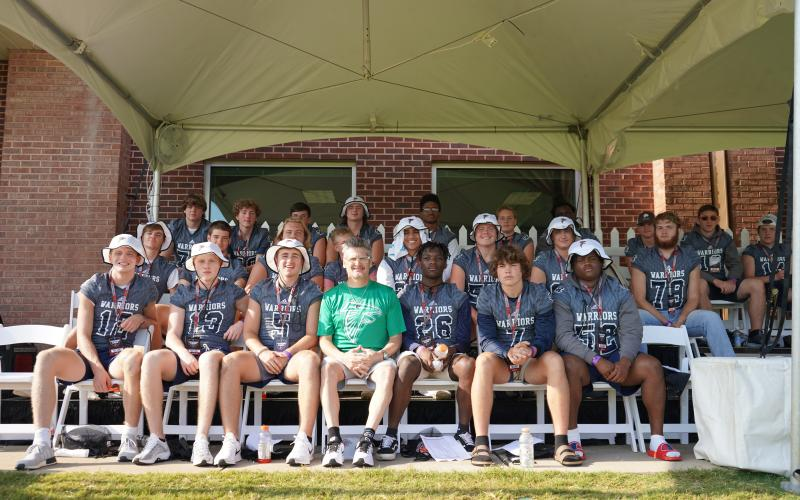 Atlanta Falcons' general manager Thomas Dimitroff, front row, center, spoke to the WCHS players during the practice session at the team's facility in Flowery Branch.