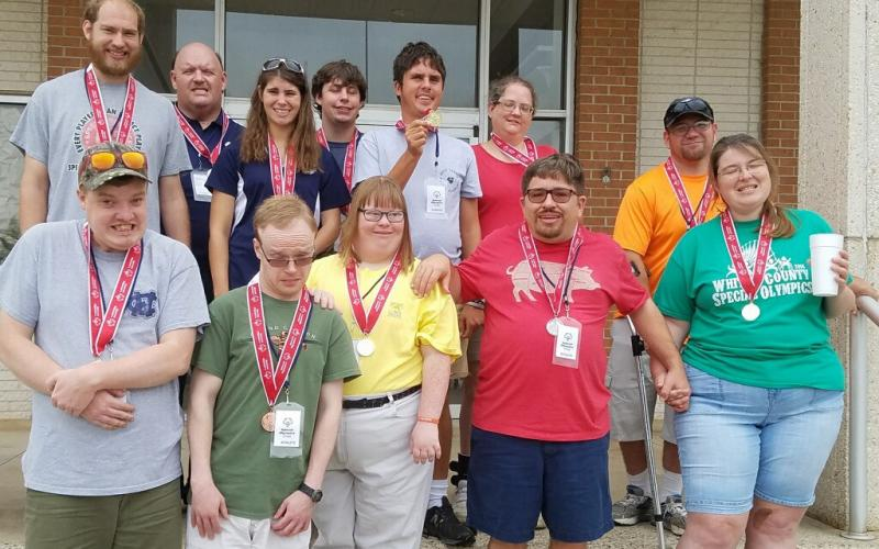 A large contingent of White County athletes participated in the Special Olympics Georgia State Masters Bowling Tournament. last weekend in Warner Robins. White County had 12 athletes competing in singles competition, which included more than 1,000 athletes from around the state. The White County group brought home nine gold medals, two silver medals and a bronze medal. The local athletes competing in the event were, front from left, Charlie Head, Trey Ward, Mary Goodman, Brian Head, and Brittany Freeman; ba