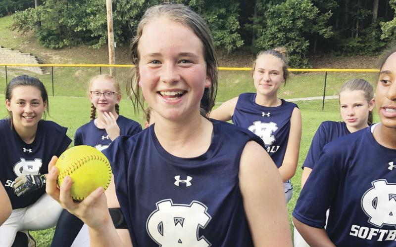 Gabby Whiddon shows off the ball after hitting a game-winning home run in the win over Union County last week. (Photo/WCMS Athletics)