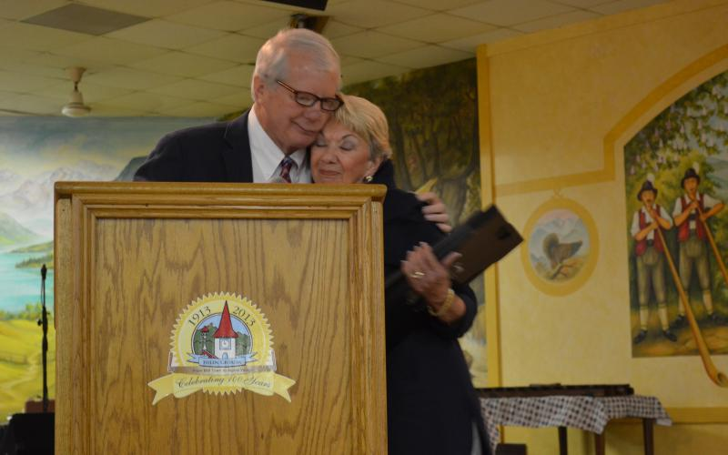 Jeff Ash and Linda Fowler hugged after he presented her with a copy of the proclamation and photos that would be installed at the Hall of Fame. (Photo/Stephanie Hill)