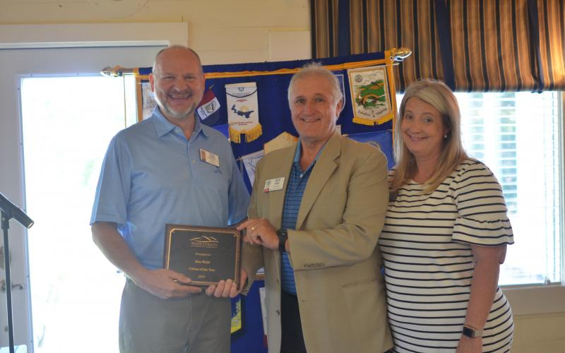 Ron Webb of Sautee Nacoochee (center) receives the 2019 Citizen of the Year Award from White County Chamber of Commerce President Beth Truelove (right) and Chamber executive board member Todd Marks, during the Sept. 3 meeting of the Rotary Club of White County. (Photo/Wayne Hardy)