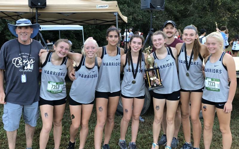 The Lady Warriors posted a runner-up finish in the girls' varsity division behind Oconee County. Members of the WCHS squad are, from left, assistant coach Tom O'Bryant, Josie Stover, Reese Vandegriff, Lily Gearing, Sydnee Nix, Maggie Davidson, head coach Matt Dover, Ellie Gearing, and Nealeigh Broadwell. (Photo/WCHS Athletics)