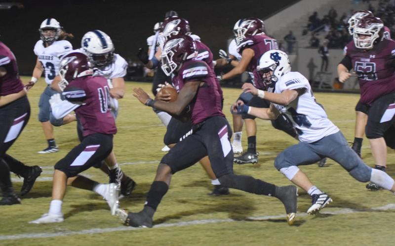 WCHS linebacker Jesse Moose, right, runs down Chestatee quarterback Christian Charles during the first half of the region game last Friday night in Gainesville. (Photos/Mark Turner)