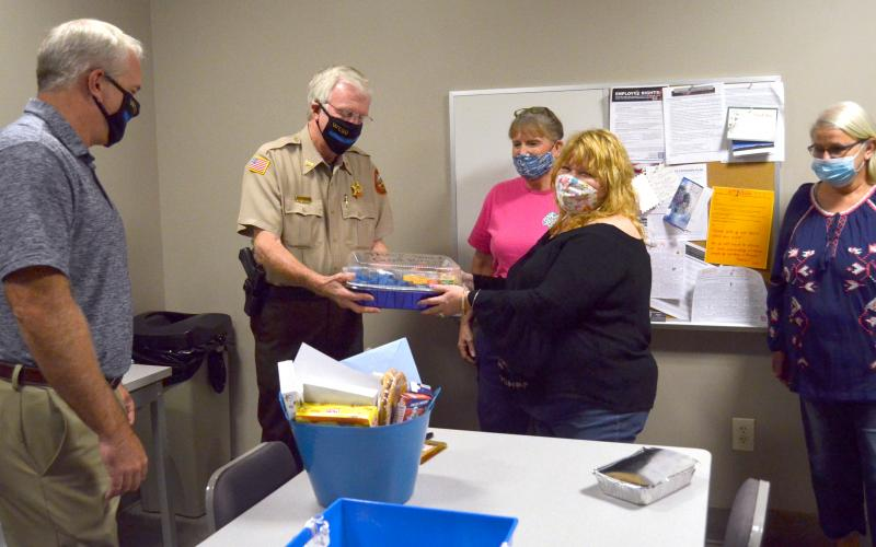 From left, White County sheriff-elect Rick Kelley and Sheriff Neal Walden accept gift baskets and treats from Ann Helms, Yvette Sindell and Sharon Worrell, who are part of a Mountain Lakes Chapel effort to show appreciation to local law enforcement. (Photo/Wayne Hardy)