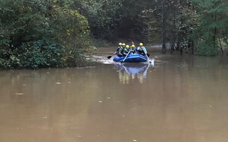 Emergency personnel rescued a family after their James Drive cabin was surrounded by water. (Photo courtesy White County Public Safety)