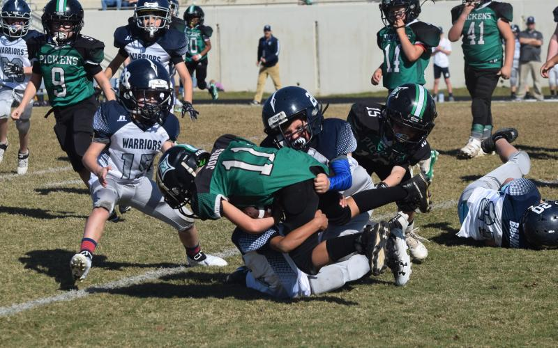 Ryder Rewis of the 8U team makes a tackle during the winning effort. (Photo/Mark Turner)