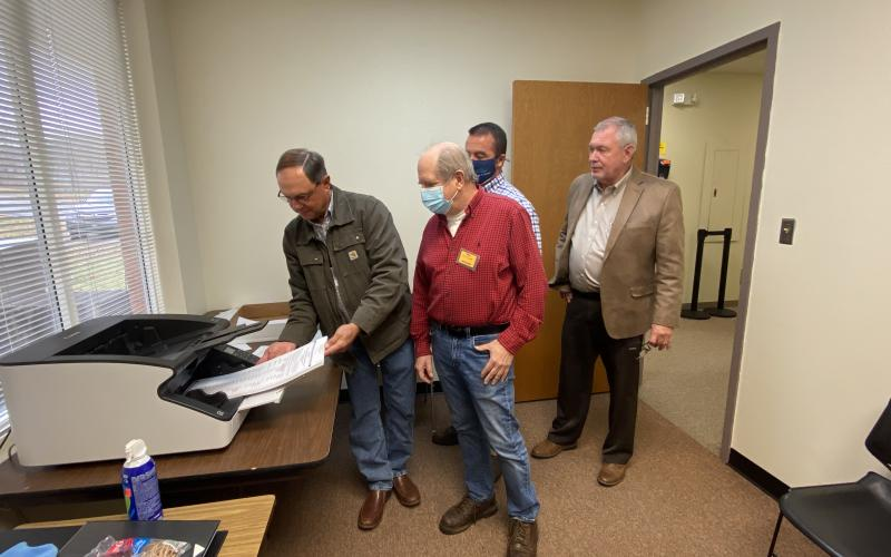 A demonstration of how ballots were scanned during the most recent recount was given Monday, Nov. 30. Shown from left are Board of Elections member Dwayne Turner, poll worker John Connell, County Chairman Travis Turner and County Elections Superintendent Garrison Baker. There were no changes to the White County results during the second recount completed last week. (Photo/Stephanie Hill)