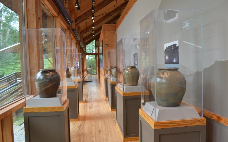 Stephanie Hill/ The Folk Pottery Museum also houses a featured exhibit that changes twice a year. Shown is an exhibit from Dave Drake, an enslaved African-American master potter and poet from the 1800s.