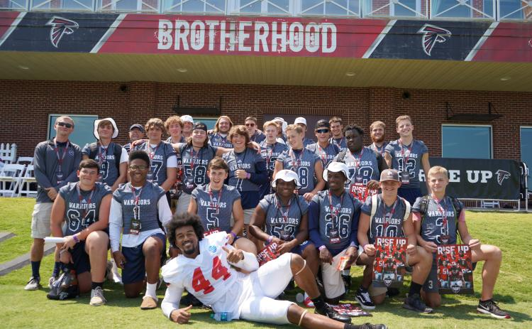 Members of the White County football team pose with Atlanta Falcons' linebacker Vic Beasley after practice last Saturday at the team's complex in Flowery Branch.