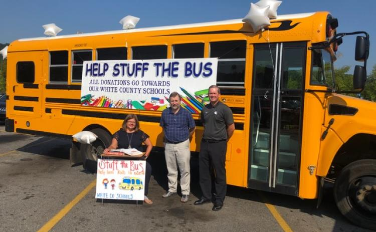 "White County School System bus driver, Jack Haas, alongside the transportation department, organized a ""Help Stuff the Bus"" school supply drive. If you would like to donate, please stop by the bus in the Wal-Mart parking lot between now and Monday, Aug. 5. Pictured are superintendent Dr. Laurie Burkett, transportation director Darren Sledge, and assistant superintendent Scott Justus."