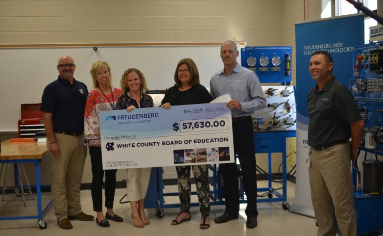 Shown from left are WCHS industrial mechanics teacher Tim Mayo, Assistant Principal Angie Helton, Principal Mary Anne Collier, White County Schools Superintendent Dr. Laurie Burkett, Gary VanWambeke (Freudenberg NOK vice president for Global Lead Center Transmission and Driveline Seals) and Wyman Hare, Cleveland plant manager for Freudenberg NOK. (Photo/Wayne Hardy)