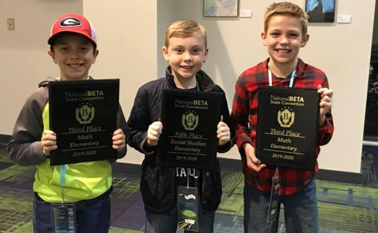 Mossy Creek students Hunter Moyers, Brody Kelley and Zachary Godfrey all proudly hold up their awards from the state competition last week in Savannah. (Submitted photos)