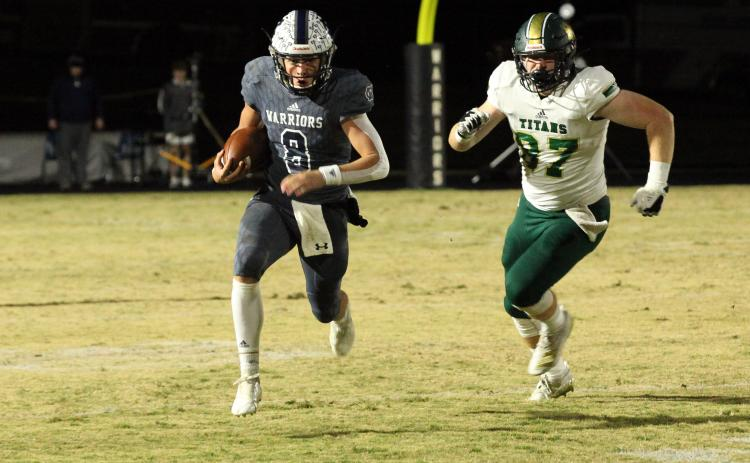 WCHS quarterback J. Ben Haynes runs away from Blessed Trinity's Grayson Gilder during the regular season finale in November.Haynes was a 7-AAAA All-region pick this season after leading the region in passing yardage and total touchdowns. (Photo/Staci Sulhoff)