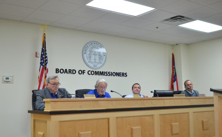 County Commissioners – from left, Terry Goodger, Craig Bryant, Travis Turner and Lyn Holcomb – discuss the outline for establishing a Board of Elections and Registration. Commissioner Edwin Nix was absent. (Photo/Wayne Hardy)