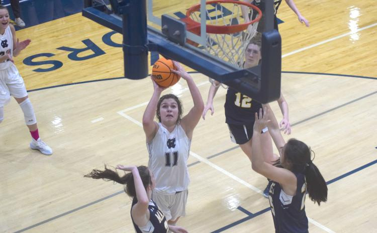 Maddie Futch puts up a shot from close range during the first quarter of the Regon 7-AAAA matchup Tuesday night in Cleveland. (Photo/Mark Turner)