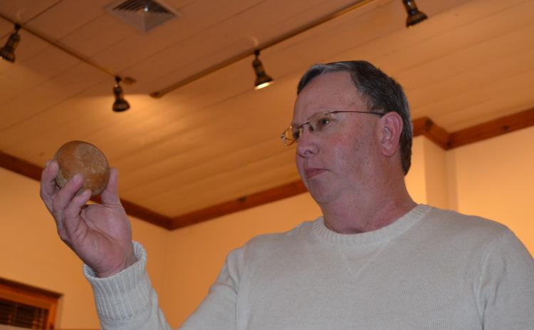 Charlie Thomas holds up a game stone that he presented at the show and tell program at the White County Historical Society meeting last week. More photos from the event are in this week's White County News. (Photo/Stephanie Hill)
