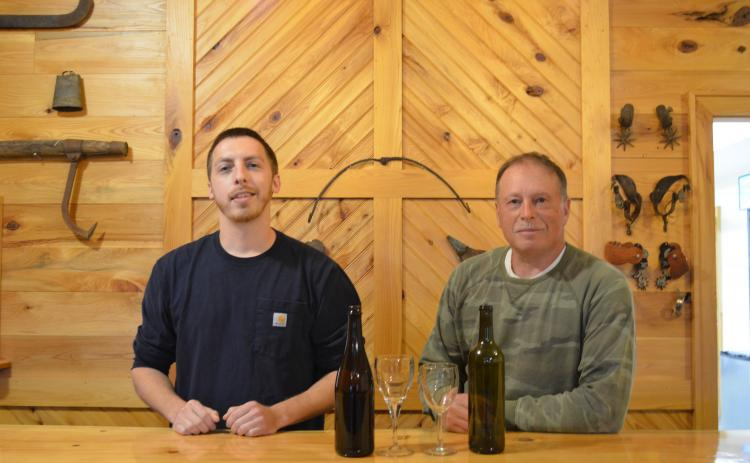 Lane Williams and Lloyd Allison stand behind the bar in the tasting room for Tesnatee River Winery and Meadery. (Photo/Stephanie Hill)
