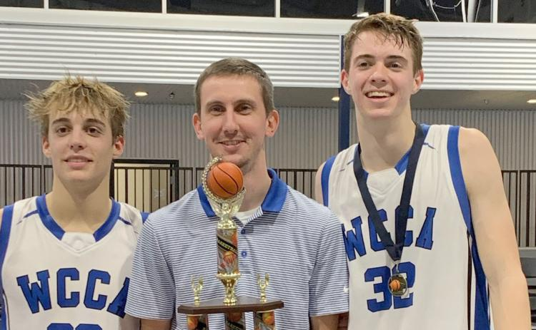 White Creek's Jim Fuller, left, head coach Preston Bowen, and Cameron Hay show off the tournament hardware after winning the Knight's Court Classic. (Photo/WCCA)
