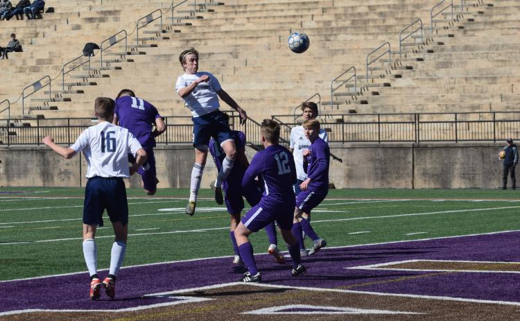 Andrew Pierce lands a header during the match with Lumpkin County. Pierce scored the winning goal in the second half. (Photo/Mark Turner)