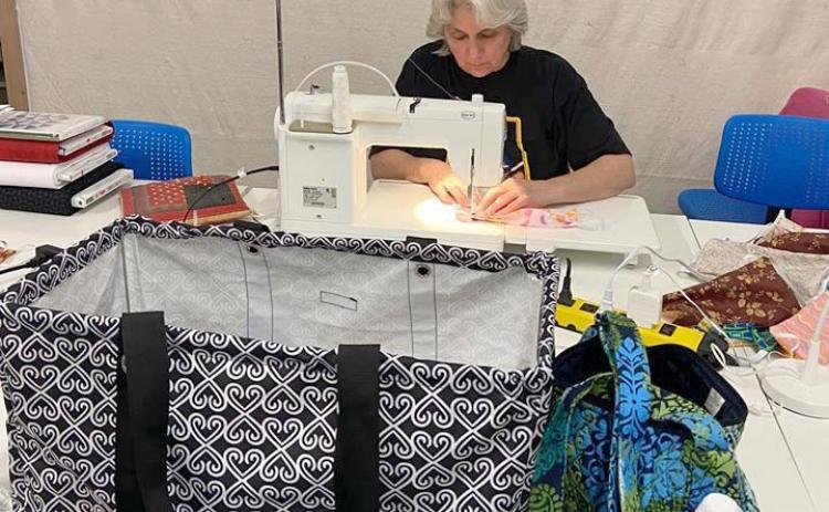 Jan Carlson works on mask kits at Quilt'n Kaboodle in Cleveland. (Photo courtesy Robbie Welch)