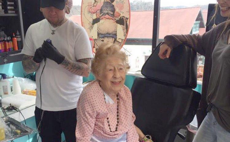"Tattoo artist Mark Ayers prepares to place a design  on 100-year-old Araminta ""Mitzi"" Bythewood of Cleveland. (Photo courtesy Ashlyn Turner)"