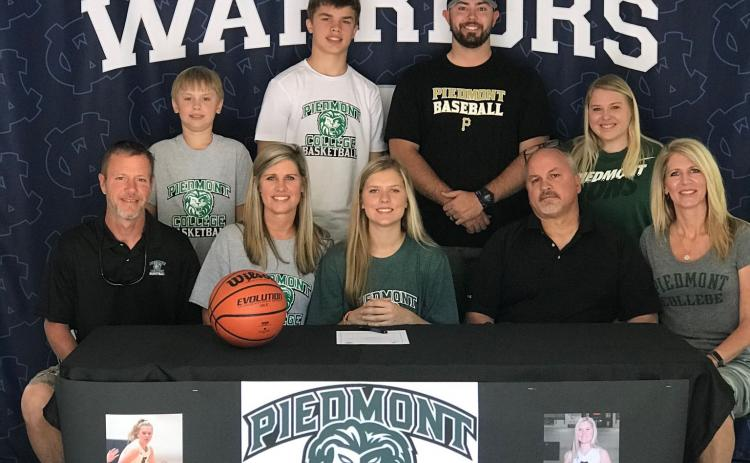 White County High School senior Bentley Cronic will continue her academic and athletic career at Piedmont College in the fall. Cronic signed a letter of intent this week to become part of the Lady Lions' basketball program. Piedmont College is a NCAA D-III college in Demorest. The Lady Lions finished 19-9 this past season, and have won three of the last four USA South tournament titles. Shown during the signing ceremony are, from from left, Galen Robinson, Amanda Robinson, Bentley Cronic, Thad Cronic, and C