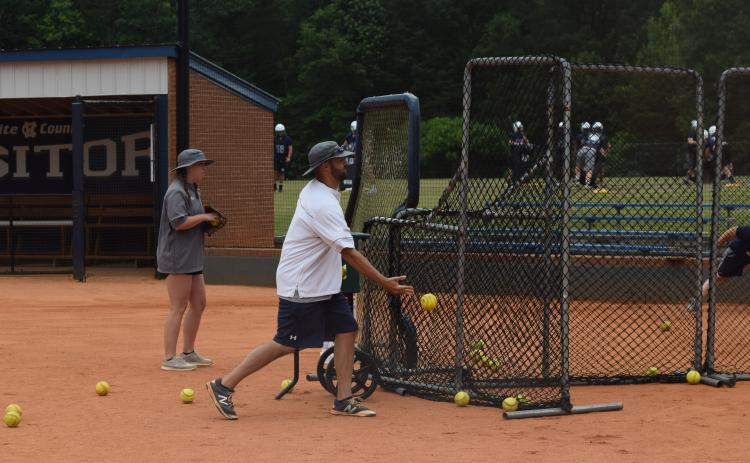 WCHS softball coach Drew Owens, shown last year during a summer workout, will be allowed to work out his players when the conditioning program begins in two weeks. (Photos/Mark Turner)