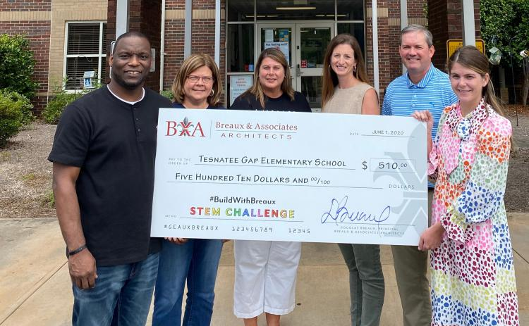 Pictured are Tesnatee Gap Elementary School  Principal Dr. Octavius Mulligan, White County School System  Superintendent Dr. Laurie Burkett, TGES Assistant Principal Diedre Alexander, Director of Student Acountability Jennifer King, Assistant Superintendent Scott Justus, and Marketing Director at Breaux & Associates  Besty Mellott, holding the check TGES received for coming in 5th place. (Submitted photo)