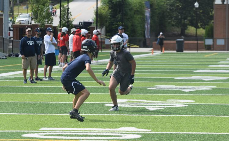 The Warriors, including senior receiver Cooper Turner, right, won't be able to compete in 7-on-7 events in June due to the COVID-19 pandemic. The team will open summer workouts next week at the high school complex.