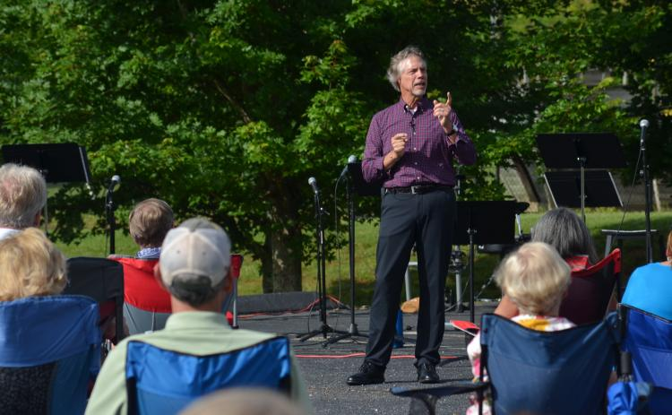 Helen First Baptist Church Pastor Jim Holmes speaks to the congregation during an outdoor service Sunday, June 28, in which Holmes was thanked for 20 years of service at the church. (Photos/Wayne Hardy)