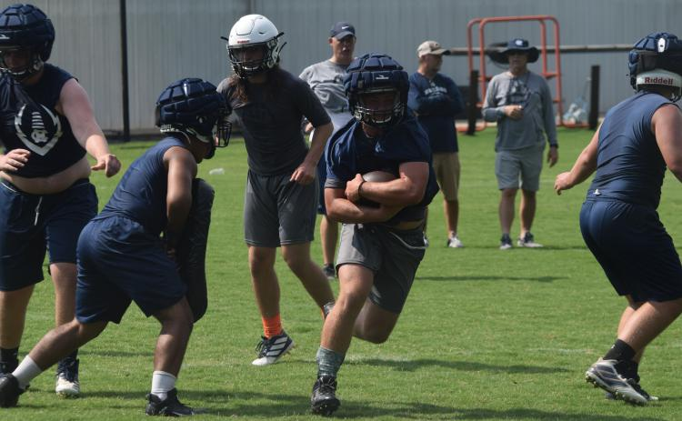 Riley Stancil heads up the field during Tuesday's workout at the WCHS football facility. (Photo/Mark Turner)