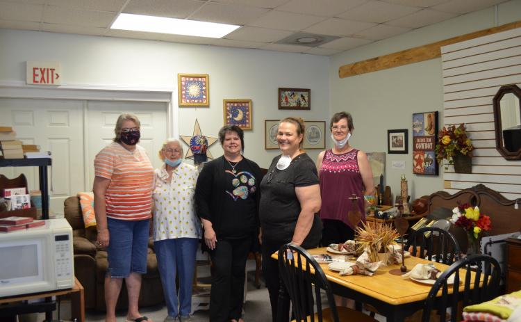 Pictured from left, are volunteers Kathy Godfrey, Virginia Edwards, Debbie Spitzer (store manager), Karen Degges and Susan Alexander at Rescue Re-Tail, a new thrift store benefitting the Charles Smithgall Humane Society. (Photo/Stephanie Hill)