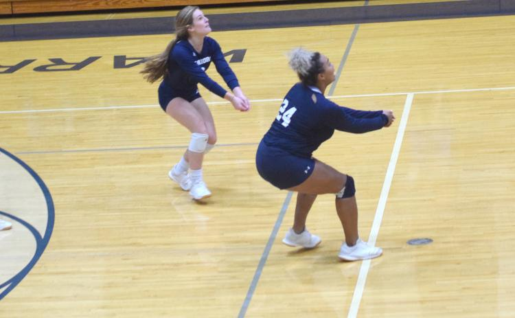 The White County volleyball team stayed atop the Area 7-AAA leaderboard with a pair of road wins Tuesday night in Oakwood.