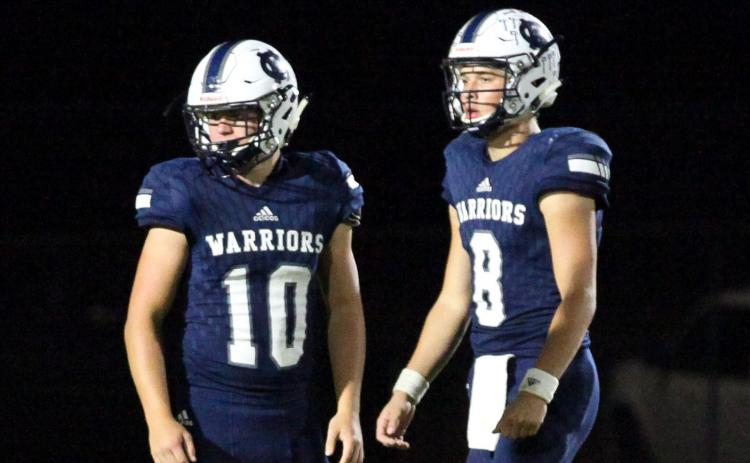Riley Stancil, leftl, J. Ben Haynes, right, and the Warriors take on Stephens County Friday night in Cleveland in the season opener. (Photo/Mark Turner)