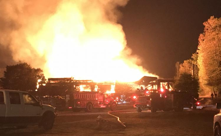 Authorities are looking into the cause of the early morning fire at North Georgia Hardwoods on Thursday, Oct. 22. (Photo/Stephanie Hill)