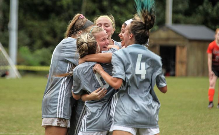 Truett McConnell's Sydney League, center, celebrates with her teammates after scoring the game-winning goal in a 1-0 victory over Union College.  (Photo/TMU Athletics)