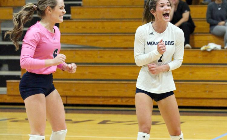 Macy Boggs, left, and Shelby Spain celebrate during the team's win over Habersham Central. (Photo/Staci Sulhoff)