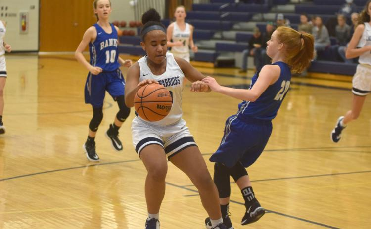 Kiannah Dorsey protects the ball during a recent eighth-grade girls game. (Photos/Mark Turner)