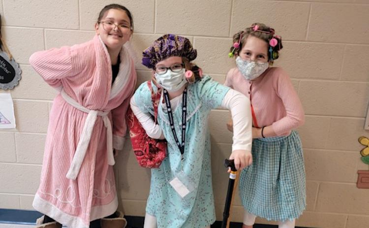 Fourth grade students Emily Roberts, Audrey Whitaker, and Harper Murphey dressed up as 100-year-old ladies.  (Submitted photos)